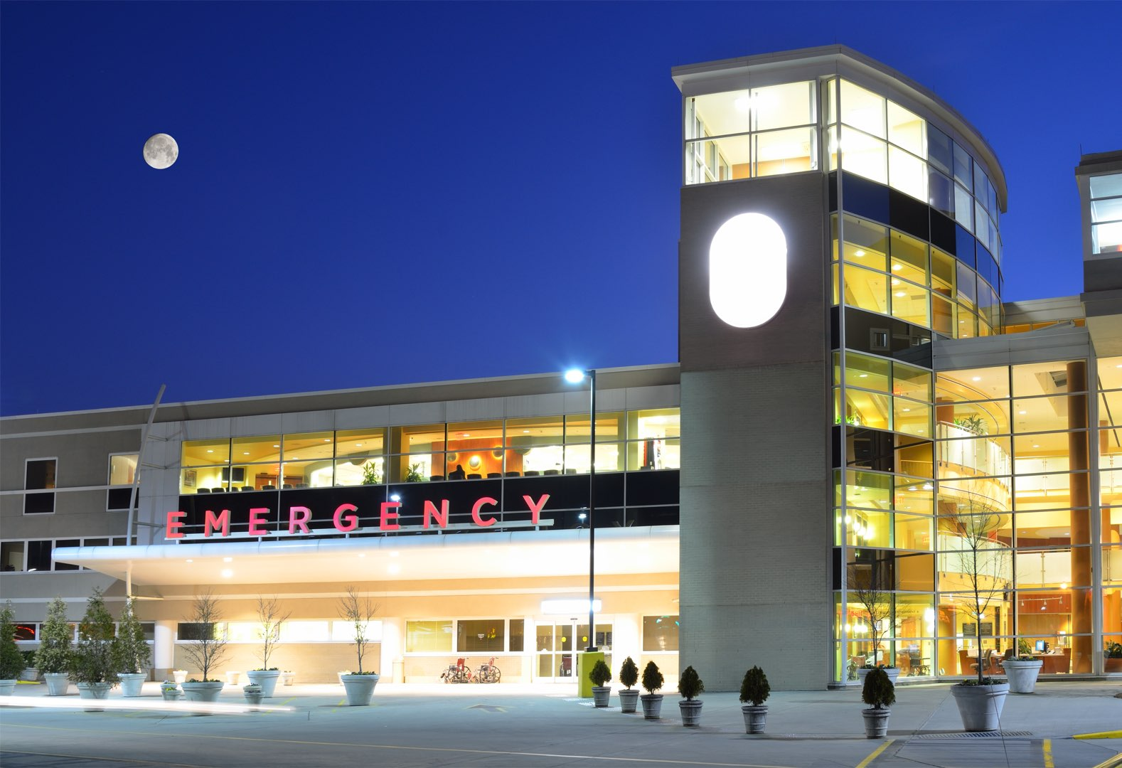 An emergency room exterior at night in the moonlight. Rain or shine, night or day, Progressive is here to help get your healthcare facility in tip-top shape but we need to fill these Grand Rapids building services jobs first!