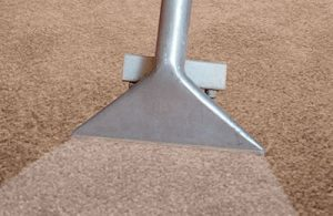 A closeup of a carpet cleaning vacuum head