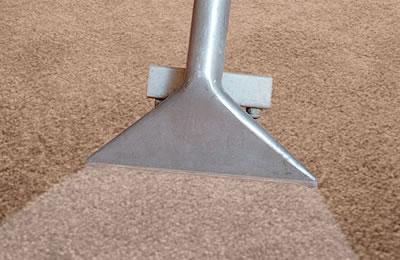 A closeup of a carpet cleaning vacuum head